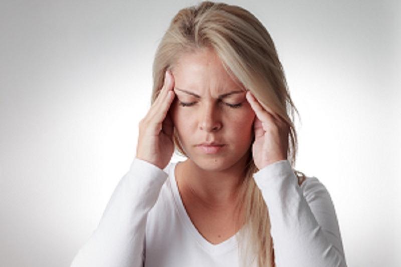 woman-holding-her-head-headache-copy