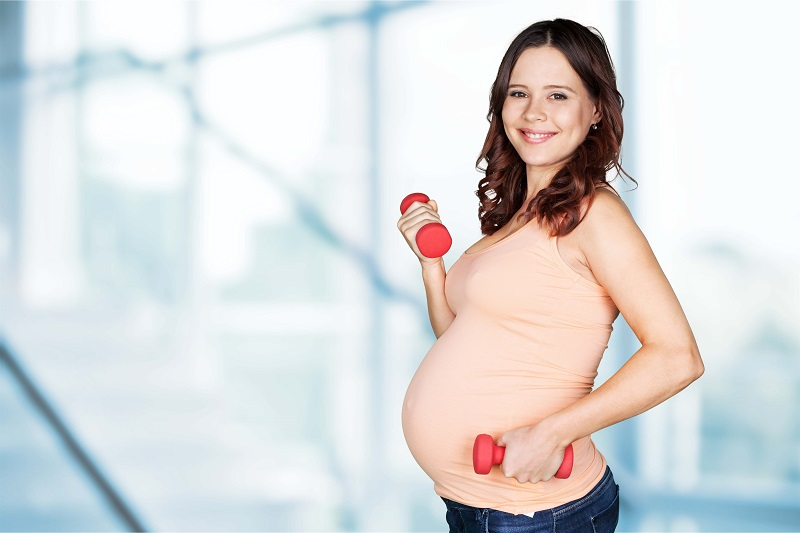 pregnant lady with dumbells