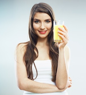 Young woman close up portrait drink juice. Female model happy smile.